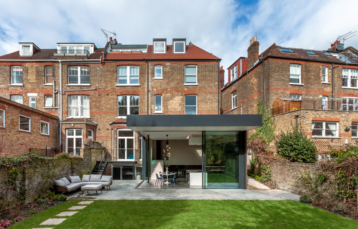 garden of victorian house with minimalist extension